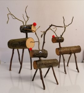Little wooden log slice reindeer, made by our young people.